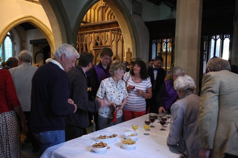 The audience enjoy a glass of wine in the interval during the summer concert, 2012.