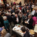 The audience enjoy home-made nibbles at the September concert, 2011.