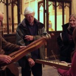 Guest storyteller Peter Hearn demonstrates some of his unusual instruments to the audience after the winter concert 2011.