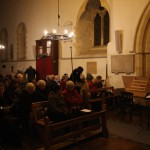 The audience come well wrapped up for the December concert in West Hanney, 2012