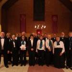 The Crown Singers with Richard Goodall after his final performance with them, at the December 2013 concert